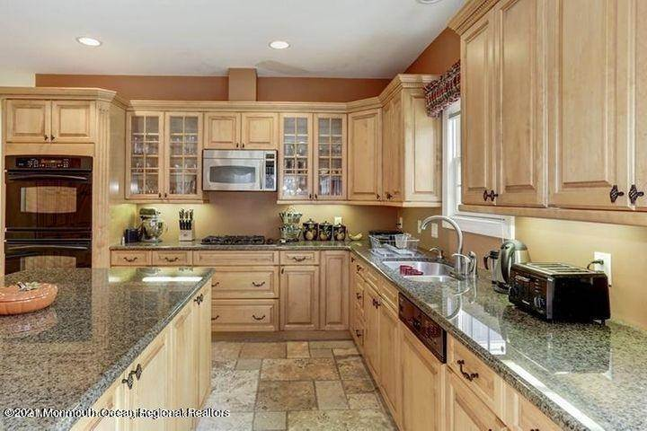 7. Single Family Homes for Sale at 27 Church Road Morganville, New Jersey 07751 United States