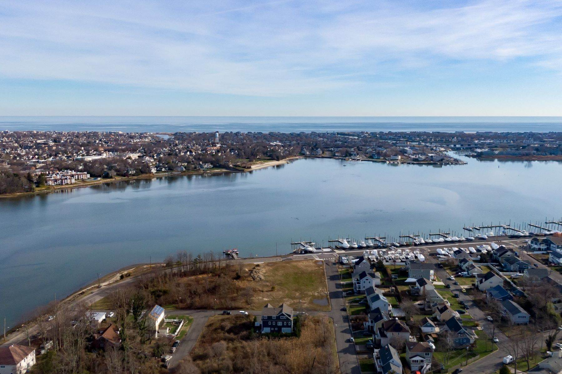 4. Single Family Homes for Sale at NEW Waterfront home to be built in desirable Shark River Hills 25 S Riverside Dr Neptune, New Jersey 07753 United States
