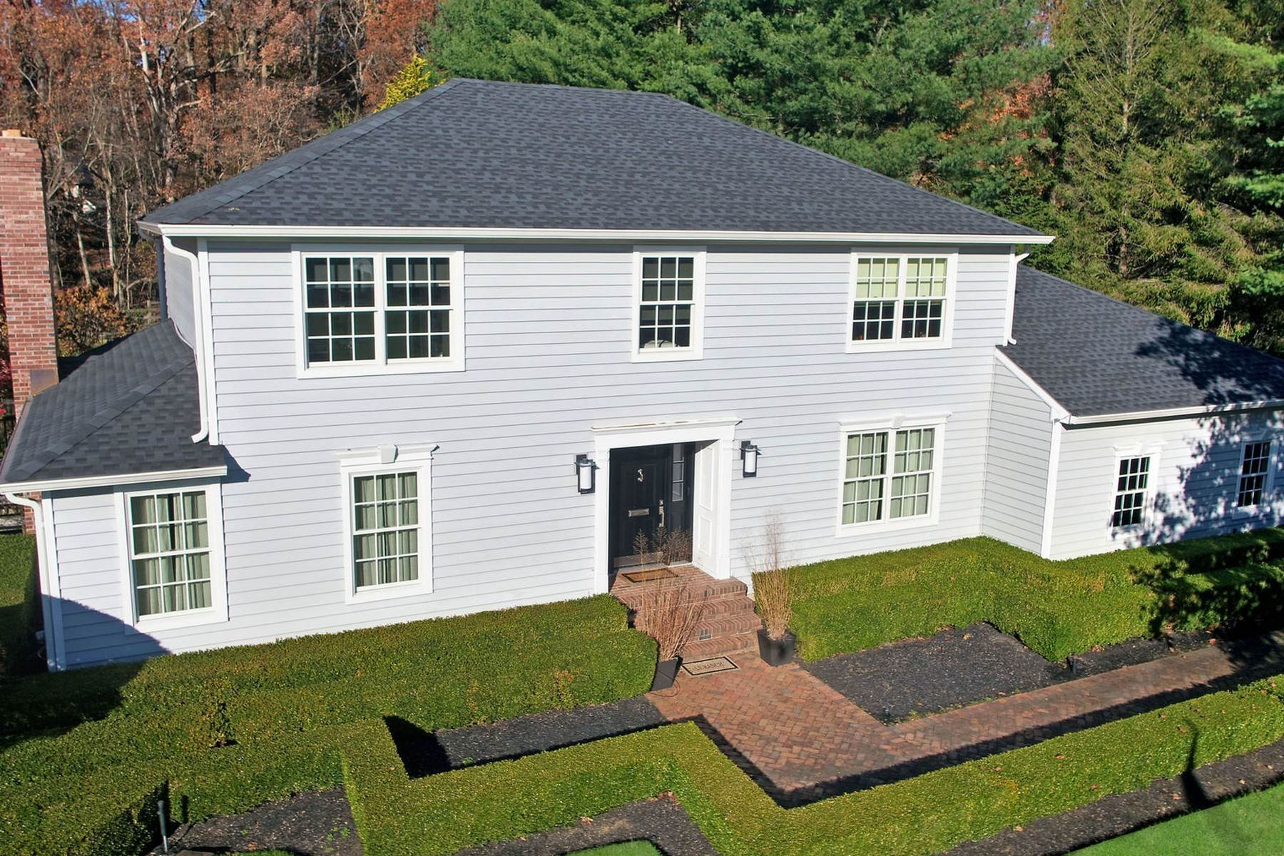 Single Family Homes for Sale at Chic Center Hall Colonial 36 Hartshorn Drive Colts Neck, New Jersey 07722 United States