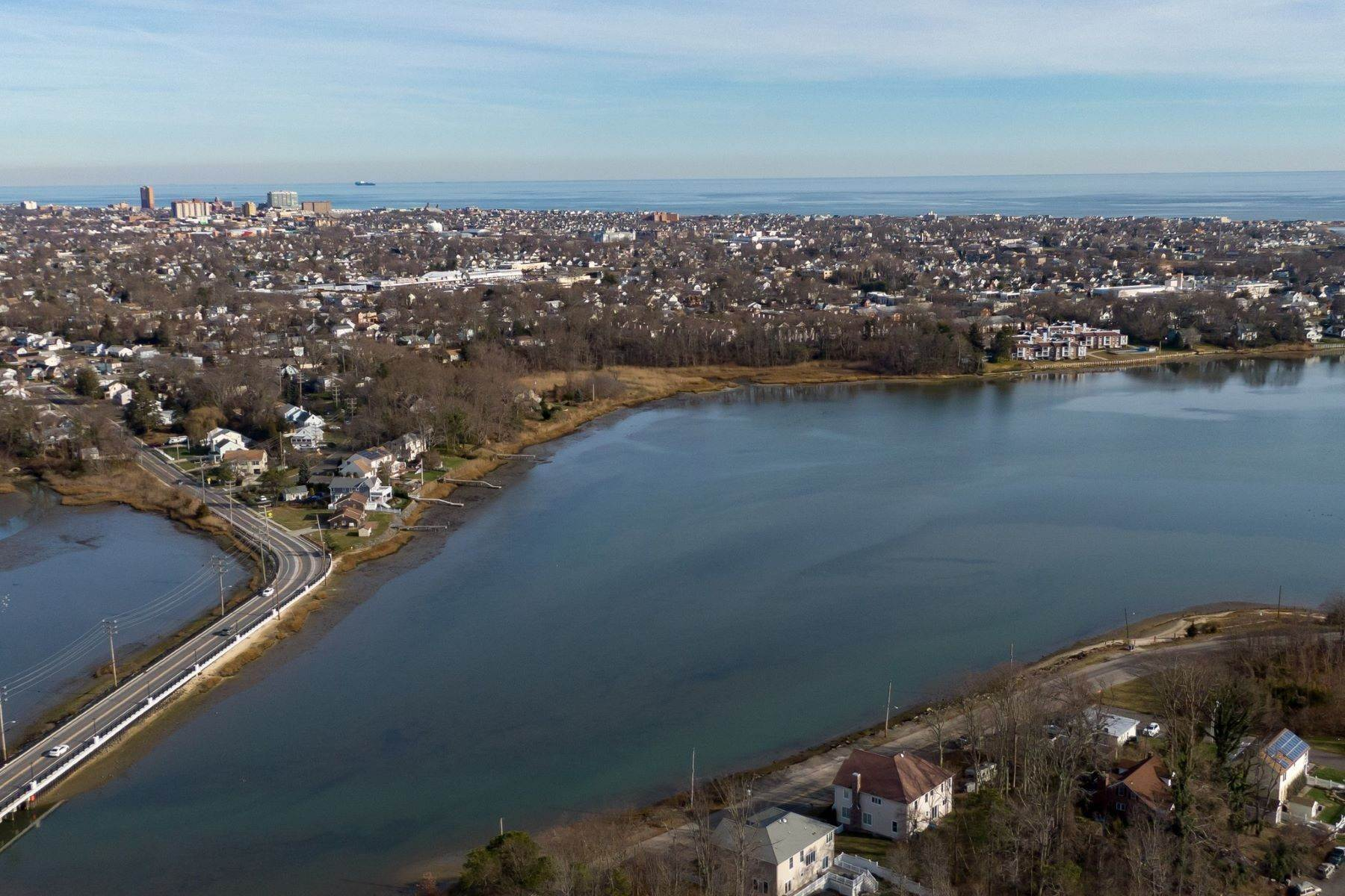2. Single Family Homes for Sale at NEW Waterfront home to be built in desirable Shark River Hills 25 S Riverside Dr Neptune, New Jersey 07753 United States