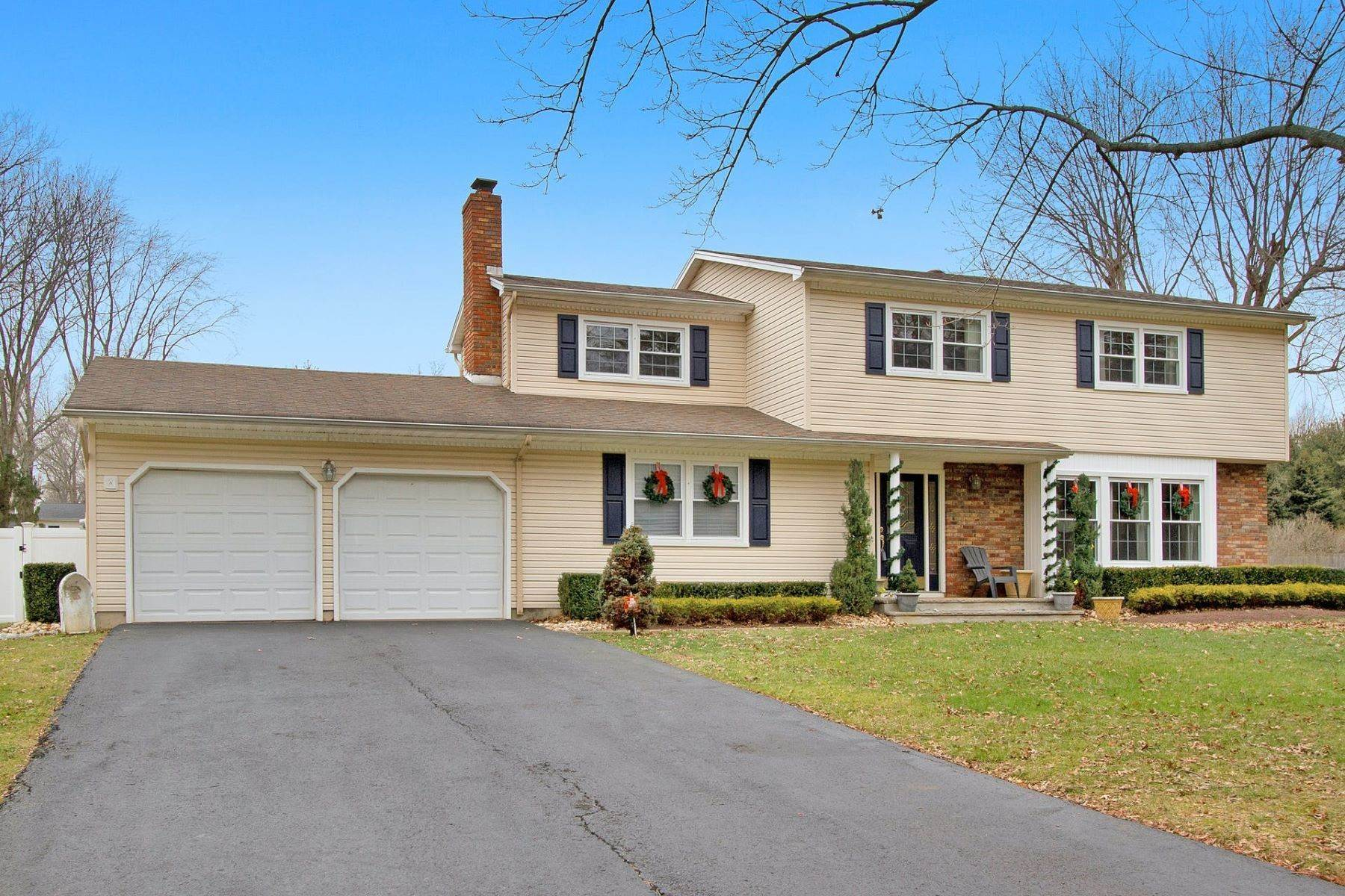 Single Family Homes for Sale at Delightful East Freehold Colonial 112 Sherwood Drive Freehold, New Jersey 07728 United States