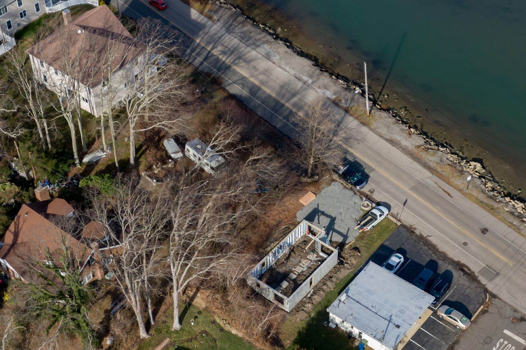 18. Single Family Homes for Sale at NEW Waterfront home to be built in desirable Shark River Hills 25 S Riverside Dr Neptune, New Jersey 07753 United States